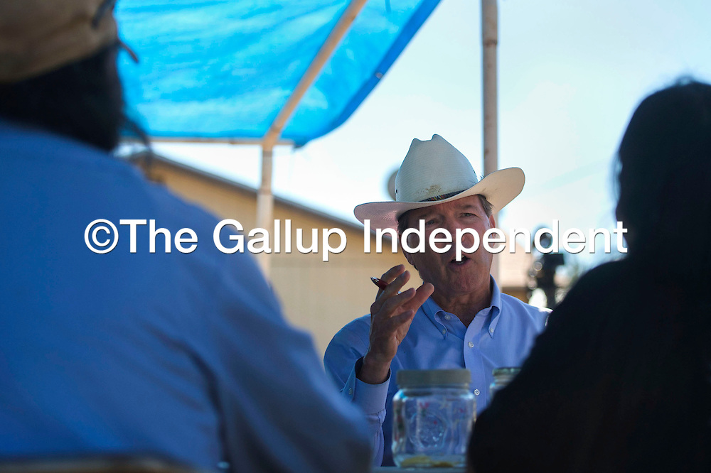 Senator Tom Udall speaks with Earl and Cheryle Yazzie at their farm in Shiprock Friday to talk about the impact of the Gold King Mine Spill on their crops a year after the spill.