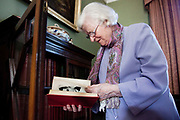 "Phyllis Dorothy James, Baroness James of Holland Park, OBE, FRSA, FRSL (born 3 August 1920), commonly known as P. D. James, is an English crime writer and Conservative life peer in the House of Lords, most famous for a series of detective novels starring policeman and poet Adam Dalgliesh. She is also the author of Children of Men, which was the basis of the feature film of the same name, directed by Alfonso Cuarón. Here she is photographed at her home in London. P.D.James is looking through the book ""The Trial of Buck Ruxton"" from her collection of real life crime stories."