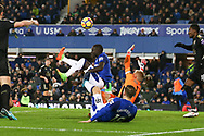 Oumar Niasse of Everton tries an overhead kick at goal but Kasper Schmeichel , the goalkeeper of Leicester city does enough to block. . Premier league match, Everton v Leicester City at Goodison Park in Liverpool, Merseyside on Wednesday 31st January 2018.<br /> pic by Chris Stading, Andrew Orchard sports photography.