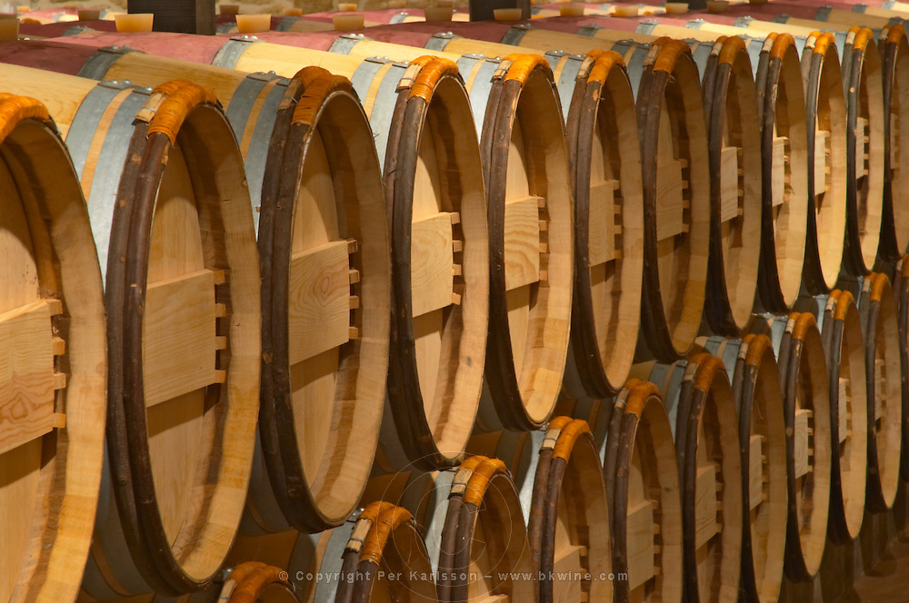 The barrel ageing cellar with rows of oak barriques Chateau Potensac Cru Bourgeois Ordonnac Medoc Bordeaux Gironde Aquitaine France
