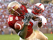 TALLAHASSEE, FL. 11/15/03-FSU's Chauncey Stovall, left, can't hang on to a pass in the end zone as N.C. State's Gregory Golden defends during first half action Saturday at Doak Campbell Stadium in Tallahassee.. COLIN HACKLEY PHOTO