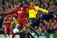 Photo: Paul Greenwood.<br />Liverpool v Arsenal. The FA Cup. 06/01/2007. Liverpool's Jamie Carragher, left, battles with Arsenal's Gilberto