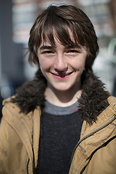 © licensed to London News Pictures. London, UK 04/03/2013. Isaac Hempstead Wright, who plays Bran Stark in Game of Thrones HBO show, helping to promote show's Season 2 DVD launch with Game of Thrones food wagon in central London. Photo credit: Tolga Akmen/LNP