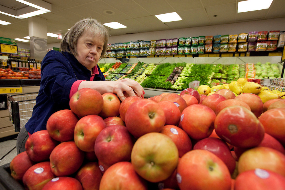 Mary Beth Solinski, a 59 year old, with Down Syndrome chooses apples in the produce section while grocery shopping at Dominick's grocery store...Aging adults with Down Syndrome. In 1983, people with Down syndrome could expect to live to age 25. Today, their life expectancy is 60 years. We interview a 59-year-old patient who has outlived her parents and is now in AARP. She has trouble walking, but has lots of interests, such as cooking, arts and crafts and reading.