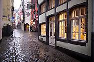 Coronavirus / Covid 19 outbreak, January 28th. 2021. The deserted Salzgasse in the old town, rainy weather,Cologne, Germany.<br /> <br /> Coronavirus / Covid 19 Krise, 28. Januar 2021. Die menschenleere Salzgasse in der Altstadt, Regenwetter,  Koeln, Deutschland.