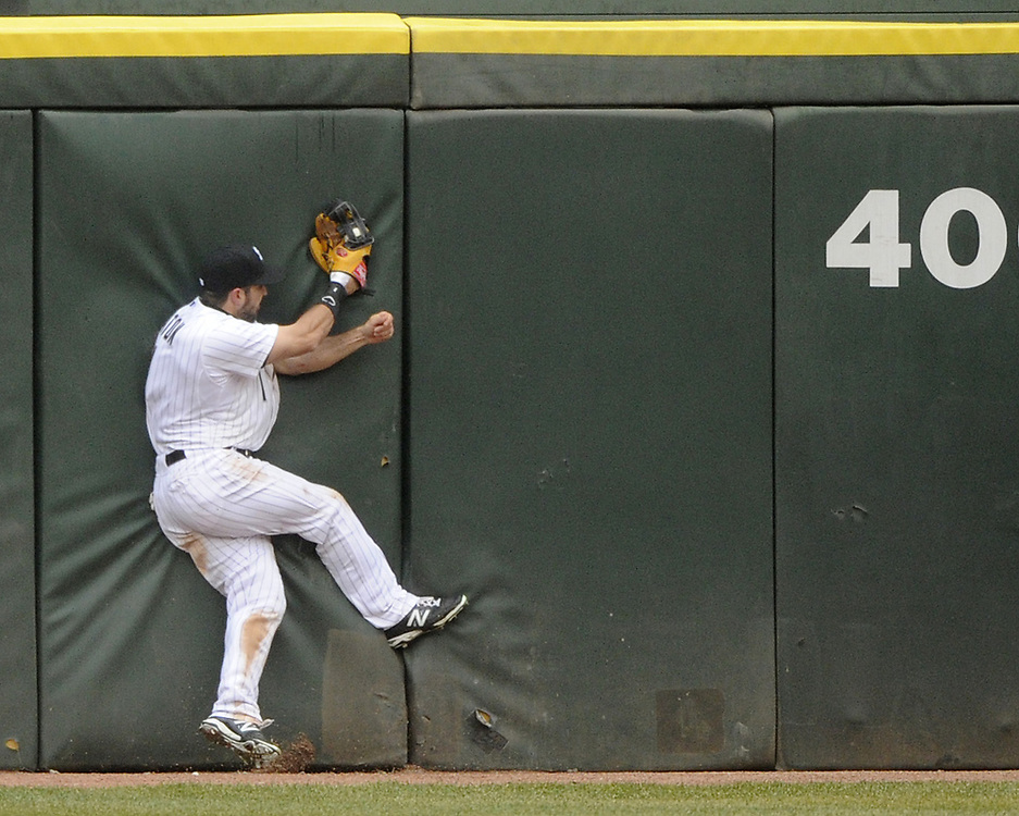CHICAGO - APRIL 03:  Adam Eaton #1of the Chicago White Sox makes a spectacular catch against the Kansas City Royals on April 3, 2014 at U.S. Cellular Field in Chicago, Illinois.  (Photo by Ron Vesely)