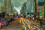 27 SEPTEMBER 2012 - BANGKOK, THAILAND: Storm clouds gather over the Asoke intersection at Soi 21 and Sukhumvit Road in Bangkok, Thailand.     PHOTO BY JACK KURTZ