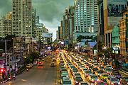 27 SEPTEMBER 2012 - BANGKOK, THAILAND: Storm clouds gather over the Asoke intersection at Soi 21 and Sukhumvit Road in Bangkok, Thailand.     PHOTO BY JACK KURTZ