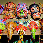 Colorful wooden masks for sale at Chichi's market. The town has become famous for its wooden carved masks that were originally part of local Maya celebrations and festivals. Chichicastenango is an indigenous Maya town in the Guatemalan highlands about 90 miles northwest of Guatemala City and at an elevation of nearly 6,500 feet. It is most famous for its markets on Sundays and Thursdays.