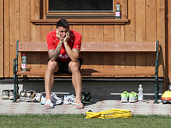 19.07.2013, Trainingsplatz, Walchsee, AUT, FC Augsburg, Trainingslager, im Bild Panagiotis VLACHODIMOS (FC Augsburg #11) sitzt mit verletztem Zeh auf der Bank am Trainingsplatz, Verletzung, verletzt, Freisteller, // during a trainings session of German 1st Bundesliga club FC Augsburg at their training camp in Walchsee, Austria on 2013/07/18. EXPA Pictures © 2013, PhotoCredit: EXPA/ Eibner/ Klaus Rainer Krieger<br /> <br /> ***** ATTENTION - OUT OF GER *****
