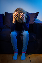 PICTURE POSED BY MODEL File photo dated 09/03/15 of a woman showing signs of anxiety. Suicides are more common on Mondays than any other day of the week, new analysis suggests.