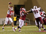 Nov 5, 2011; Fayetteville, AR, USA;  Arkansas Razorback quarterback Tyler Wilson (8) makes a pass as offensive guard Grant Cook (72) blocks South Carolina Gamecock defensive tackle Kelcy Quarles (99)during the first half of a game against the South Carolina gamecocks at Donald W. Reynolds Stadium.  Mandatory Credit: Beth Hall-US PRESSWIRE
