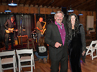 Gomez and Morticia Bob and Cindy Marcotte join in the Monster Ball for Pitman's Freight Room on Sunday afternoon.  (Karen Bobotas/for the Laconia Daily Sun)