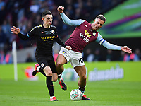Football - 2020 EFL Carabao (League) Cup Final - Aston Villa vs. Manchester City<br /> <br /> Aston Villa's Jack Grealish battles for possession with Manchester City's Phil Foden, at Wembley Stadium.<br /> <br /> COLORSPORT/ASHLEY WESTERN
