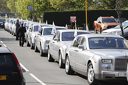 © Licensed to London News Pictures. 21/04/2018. Cobham, UK. A fleet of Silver Rolls Royces make up the distance for the funeral of traveller 'Queenie, Elizabeth Doherty at Sacred Heart Church in Cobham, Surrey. Elizabeth Doherty, whose son Paddy Doherty is known for appearing on My Big Fat Gypsy Wedding and winning Celebrity Big Brother 8, died of a heart attack earlier this month. Paddy Doherty claimed his mother has died of a 'broken heart' following the death of her husband almost a year ago. Photo credit: Peter Macdiarmid/LNP