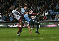 Photo: Steve Bond.<br /> Coventry City v West Ham United. Carling Cup. 30/10/2007. Luis Boa Morte (L) sqezzes a shot on goal