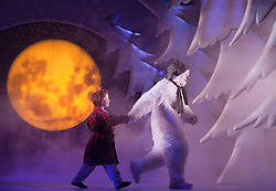 """© Licensed to London News Pictures. 30/11/2011. London, UK. The Birmingham Repertory Theatre Production of """"The Snowman"""" opens at the Peacock Theatre, London, for a run until 8 January 2012. With James Leece as """"The Snowman"""" and Charlie Salsen as """"The Boy"""". Photo credit: Bettina Strenske/LNP"""