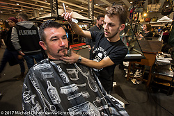 Getting a haircut at Motor Bike Expo. Verona, Italy. Saturday January 21, 2017. Photography ©2017 Michael Lichter.