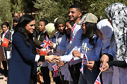 The Duchess of Sussex greets students during their visit to the local Secondary School, Lycee Qualifiant Grand Atlas, where they met with students and teachers in Asni Town, Atlas Mountains on the second day of their tour of Morocco.