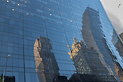 Reflections in the glass side of 9 W 56th St, by Skidmore Owings & Merrill.