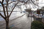 Cologne, Germany, February 4th. 2021, flood of the river Rhine, flooded promenade, on the right the access road to the Rhine bank tunnel.<br /> <br /> Koeln, Deutschland, 4. Februar 2021, Hochwasser des Rheins, rechts die Einfahrt zum Rheinufertunnel.