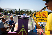 Musicians play tunes in the road outside the gates in New Preston Road, Lancashire, United Kingdom, June 29th 2018.  Block Around the Clock - a fourty eight hours of event with work shops, yoga, sleeping and anti-fracking campaigning in front of the gates to Cuadrillas fracking site in Lancashire. The event was organised by anti-fracking campaigners in spite of an injunction granted to Cuadrilla to prevent protest against the impending shale gas exploitation. The Cuadrilla site in Lancashire in a highly contested site, almost ready to drill for gas.