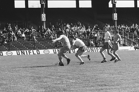 Cork attempts to grab the ball from underneath Wexford during the All Ireland Senior Camogie Final Cork v Wexford in Croke Park on the 21st September 1975. Wexford 4-3 Cork 1-2.