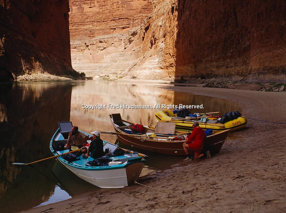 Boatman Kenton Grua and Boatwoman Ellen Tibbets discussing Colorado River trip during break at Redwall Canyon, Marble Canyon, Grand Canyon National Park, Arizona.