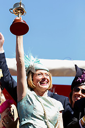 © Licensed to London News Pictures. 5/11/2013. Gai Waterhouse the trainer of Fiorente holds up the Melbourne Cup after winning race 7 the Emirates Melbourne Cup during Melbourne Cup Day at Flemington Racecourse on November 5, 2013 in Melbourne, Australia. Photo credit : Asanka Brendon Ratnayake/LNP