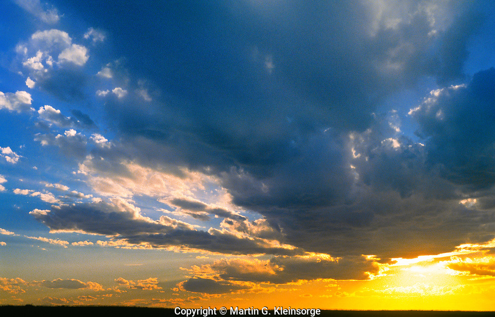 Cumulus mediocris clouds at sunset.  Pawnee Nationl Grasslands,  Colorado.