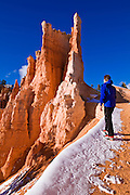 Rock formations and hiker on the Queens Garden Trail, Bryce Canyon National Park, Utah