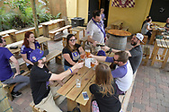Soccer fans drink at tables on the outdoor patio of Barley & Vine, A Craft Beer Garden, which is located in the area known as the Milk District in Orlando, Fla., Saturday, March 25, 2017. (Phelan M. Ebenhack via AP)