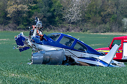 © Licensed to London News Pictures. 26/04/2021. High Wycombe, UK. Emergency services and a damaged plane in a field following a crash at Wycombe Air Park, also known as Booker Airfield. the incident occurred at approximatly 10:30 BST when the plane crashed through bushes at the end of the runway coming to rest in a field. Photo credit: Peter Manning/LNP