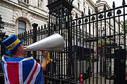 On the day the five week suspension of British Parliament begins, pro remain campaign Steve Bray shouts through a megaphone  outside Downing Street in London, United Kingdom on 10th September 2019.