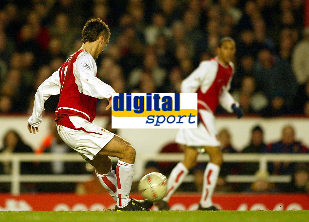 Photo: Scott Heavey.<br /> Arsenal v Middlesbrough. FA Cup Fourth Round. 24/01/2004.<br /> David Bentley delicaltely chips the ball over the head of Mark Schwarzer to earn Arsenal a 4-1 win