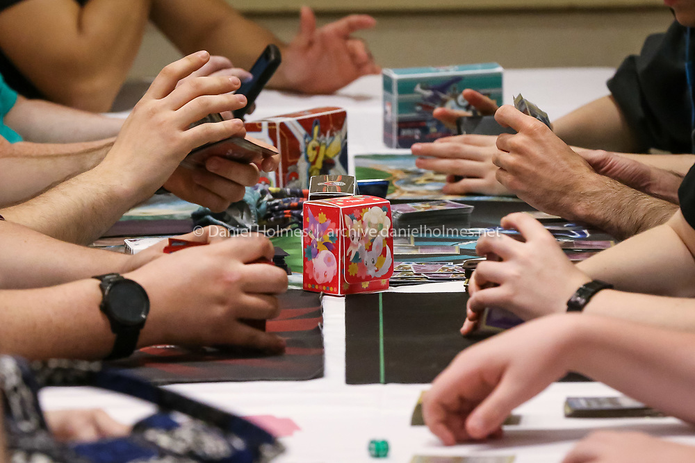 (5/28/16, MARLBOROUGH, MA) Hands work at a furious pace during the 2016 Pokémon Spring Regional Championships at Best Western Royal Plaza Hotel in Marlborough on Saturday. Daily News and Wicked Local Photo/Dan Holmes