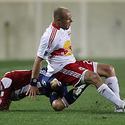 New York Red Bulls player Joel Lindpere (right) fouls Alejandro Moreno, Chivaas USA, during the New York Red Bulls V Chivas USA Major League Soccer match at Red Bull Arena, Harrison, New Jersey, 23rd May 2012. Photo Tim Clayton