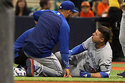 May 6, 2018 - St. Petersburg, FL, U.S. - ST. PETERSBURG, FL - MAY 06: Aledmys Diaz (1) of the Blue Jays appears to be in pain as he is checked out on the field after safely running to first base during the MLB regular season game between the Toronto Blue Jays and the Tampa Bay Rays on May 06, 2018, at Tropicana Field in St. Petersburg, FL. (Photo by Cliff Welch/Icon Sportswire) (Credit Image: © Cliff Welch/Icon SMI via ZUMA Press)