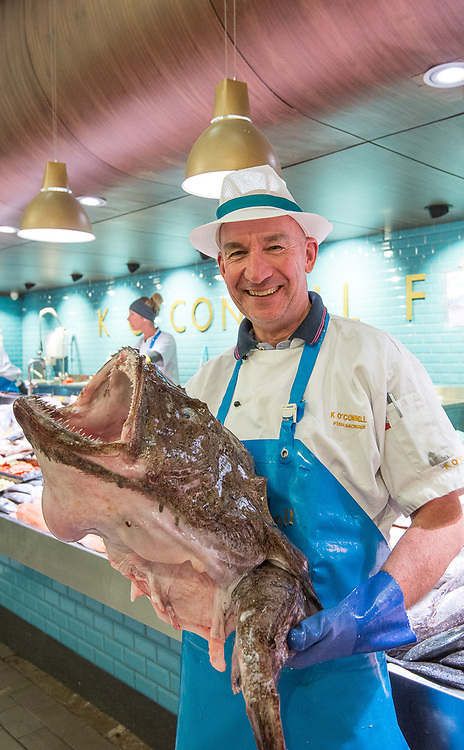 Pat O'Connell holds a monkfish at the K O'Connell fishmonger stall in the English Market of Cork City, Ireland.
