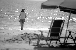 Kathleen Kirkwood of Oakland, Calif. walks along the Atlantic Ocean at the Henlopen Acres Beach Club in Rehoboth Beach, Del., Monday, Aug. 19, 2019. (Photo by D. Ross Cameron)