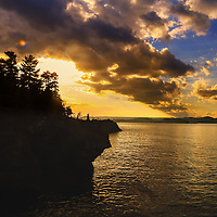 """""""The Day After"""" <br /> <br /> Rock cliffs and trees in silhouette above Lake Superior at sunset!"""