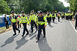 © London News Pictures. 27/07/2013. Balcombe, UK.  Large number of police at the site. Anti Fracking demonstrators and local villagers attempt to blockade a drilling site in Balcombe, West Sussex which has been earmarked for fracking. A number of demonstrators at the site have been arrested. Photo credit: Ben Cawthra/LNP