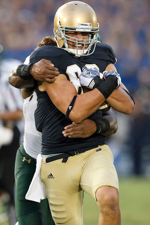 Notre Dame tight end Tyler Eifert (#80) runs for yardage after the catch in action during NCAA football game between Notre Dame and South Florida.  The South Florida Bulls defeated the Notre Dame Fighting Irish 23-20 in game at Notre Dame Stadium in South Bend, Indiana.