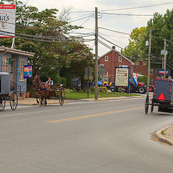Intercourse, PA, USA - June 17, 2012: A single-axle horse-drawn buggy with regular buggies in Intercourse, PA