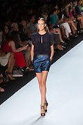 Glittery blue shorts and a navy cap-sleeved top. By Monique Lhuillier at Spring 2013 Fall Fashion Week in New York.