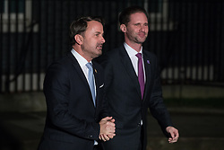 London, UK. 3 December, 2019. Xavier Bettel (l), Prime Minister of Luxembourg, leaves with his husband Gauthier Destenay following a reception for NATO leaders at 10 Downing Street on the eve of the military alliance's 70th anniversary summit at a luxury hotel near Watford.
