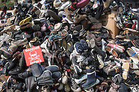 A pile of shoes on display as part of an anti land mine campaign at Place Masséna in Nice the South of France