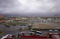"""(Image four of nine) Panorama of the Ensenada harbor in Mexico on a grey and raining day from the deck of the MV World Odyssey. The other cruse ship is the Carnival Imagination. Once all of the students, faculty, staff, and life long learners were aboard we would be ready to begin the 102 day """"round the world"""" Semester at Sea Spring 2016 Voyage. Composite of nine images taken with a Leica T camera and 23 mm f/2 lens (ISO 250, 23 mm, f/2, 1/80 sec). Panorama stitched using AutoPano Giga Pro."""
