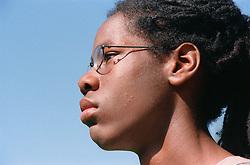 Portrait of teenage boy wearing glasses looking serious,