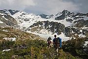 Climbers Jim Prager and Obadiah Reid hike into the campground at Wedgemount Lake in Garibaldi Provincial Park, British Columbia, Canada on June 13, 2009.